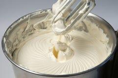 Cream on a mixer Stock Photos