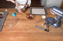 Cream mixing on kitchen table with kitchenware Royalty Free Stock Photo