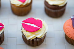 Cream muffins with lips. Muffin with cream and pink lips royalty free stock photography