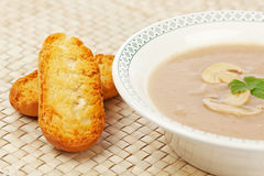 Cream of mushroom soup and bread croutons Stock Photography