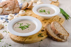 Cream of mushroom soup. With homemade bread and herbs Stock Photo
