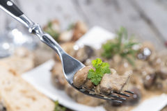 Cream Mushrooms on a Fork Royalty Free Stock Photography