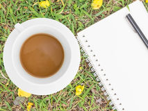 Cream notebook with pen and cup of coffee Royalty Free Stock Image