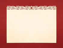 Cream Paper with Handmade Fancy Cutout Border. Vintage Cream Paper with Handmade Fancy Cutout Border isolated on Orange background Stock Photo