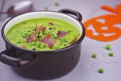 Cream pea soup with bacon Stock Photos