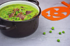 Cream pea soup with bacon Stock Images