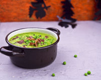 Cream pea soup with bacon Royalty Free Stock Images