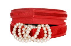 Cream pearls in a red box Stock Photo