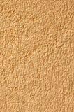 Cream pebble-dash render background. Cream pebble-dash render coated background, with copy space,seamless,wallpaper,horizontal or vertical royalty free stock photo