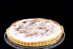 Cream pie with cinnamon in the glass service plate royalty free stock images