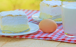 Cream pie - cream cake. On plate and glass of milk Stock Photography