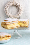 Cream pie made of two layers of puff pastry, filled with whipped Royalty Free Stock Image