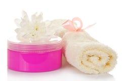 Cream in pink packing, towel and chrysanthemum Royalty Free Stock Image