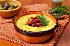 Cream of potato and leek with toasted bacon Stock Photos