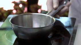 Cream pouring into saucepan. stock video