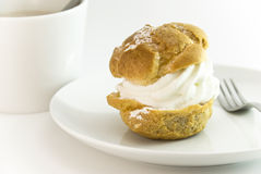 Cream puff with coffee setting. Cream puff with white coffee setting and fork stock images
