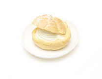 Cream puff on a dish Royalty Free Stock Photography