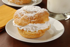 Cream puff and milk Royalty Free Stock Photography
