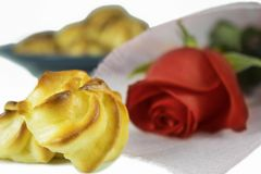 Cream puff pastry and red rose. royalty free stock images