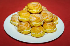Cream puff pile on white plate Stock Image
