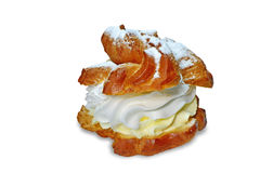 Cream puff - profiterole. Cream puffs filled with whipped cream and custard, sprinkled with powdered sugar Stock Images