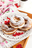 Cream puff rings decorated with fresh red currant Royalty Free Stock Image