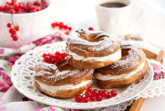 Free Cream Puff Rings Decorated With Fresh Red Currant Royalty Free Stock Image - 44066546
