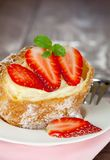 Cream puff with strawberry Stock Images