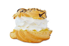Cream puff with vanilla custard and whipped cream isolated Royalty Free Stock Photos