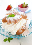 Cream puff with whipped cream Stock Photos