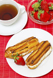 Cream puff with whipped cream,strawberry, tea Stock Image