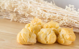 Cream Puff on Wood Table. Homemade cream puff, choux, eclair on wood table Stock Photos