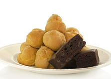 Cream puffs and brownie Stock Photography