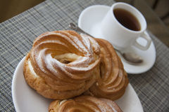 Cream puffs and coffee Stock Photography