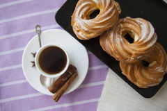 Cream puffs with espresso Stock Photography