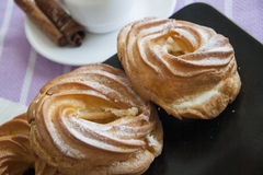 Cream puffs with espresso Royalty Free Stock Images