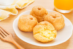 Cream puffs and juice Royalty Free Stock Photos