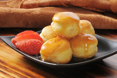 Cream puffs with strawberries Royalty Free Stock Images