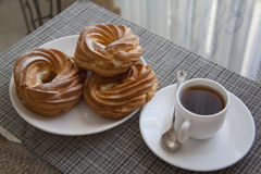 Cream puffs on table Royalty Free Stock Photo