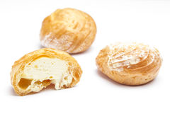 Cream puffs on a white Royalty Free Stock Images