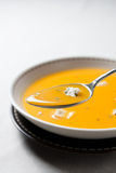 Cream of pumpkin soup with blue cheese Stock Images