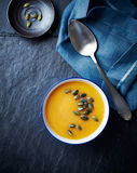 Cream of pumpkin soup with pumpkin seeds Stock Photo