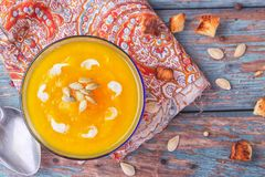 Cream of roasted pumpkin spicy soup traditional simple vegetarian autumn vegetable healthy organic diet homemade food meal on. Vintage wooden table background stock image