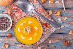 Cream of roasted pumpkin spicy soup traditional simple vegetarian autumn vegetable healthy organic diet homemade food meal on. Vintage wooden table background stock photography