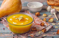 Cream of roasted pumpkin spicy soup traditional simple vegetarian autumn vegetable healthy organic diet homemade food meal on. Vintage wooden table background stock photos