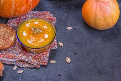 Cream of roasted pumpkin spicy soup traditional simple vegetarian autumn vegetable healthy organic diet homemade food meal on. Black background stock images