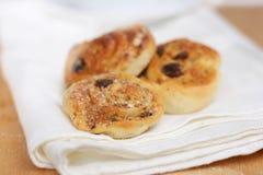 Cream rolls. Homemade cream rolls (buns) with raisins and nuts stock image