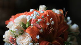 Cream roses,orange lilies and tiny white flowers Royalty Free Stock Photography