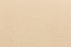 Cream rough wall background. /texture Royalty Free Stock Photos