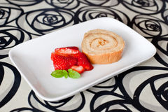 Cream roulade. Homemade cream roulade decorated with fresh strawberries Royalty Free Stock Image